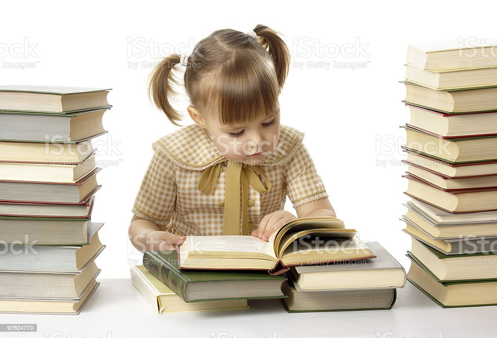 Cute little girl is reading book royalty-free stock photo