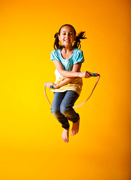 Cute Little Girl Jump Roping stock photo
