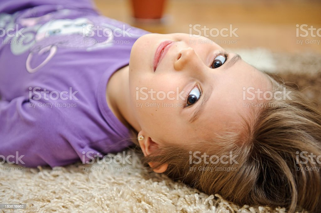 Cute little girl lies on the floor royalty-free stock photo
