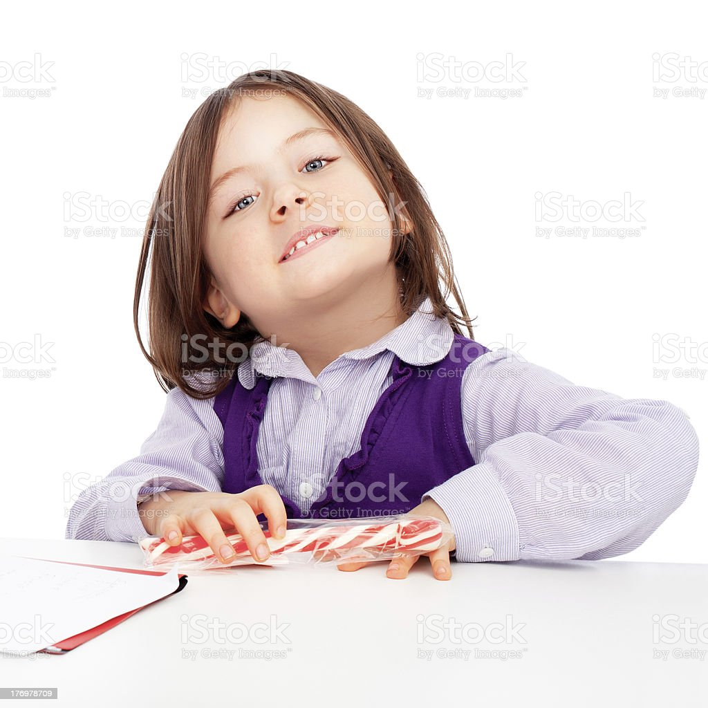 Cute little girl looking at the camera royalty-free stock photo