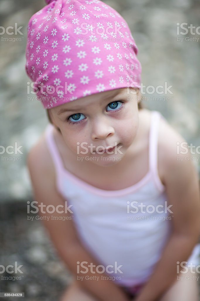 cute little girl looking for someone or something stock photo