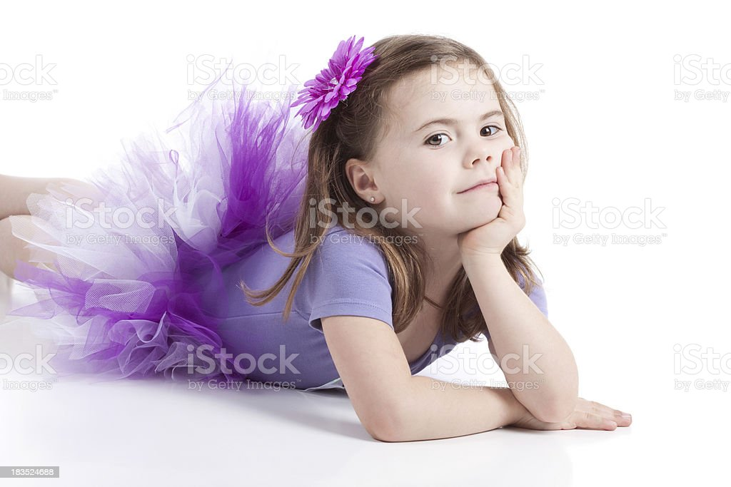 Cute Little Girl Lying on White Background Wearing Tutu royalty-free stock photo