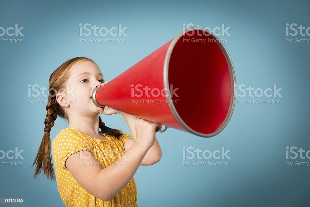Color image of a seven year old girl making an announcement/giving...