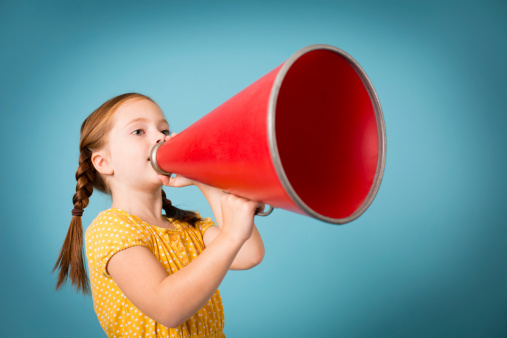 Cute Little Girl Making Announcement With Megaphone Stock Photo - Download Image Now