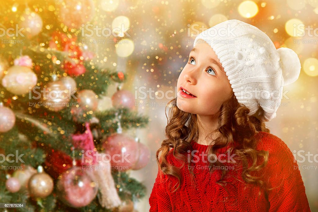 Cute little girl near Christmas tree. New Year card stock photo