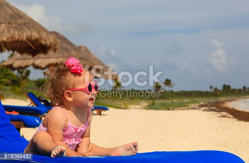 istock cute little girl on summer beach 515263432