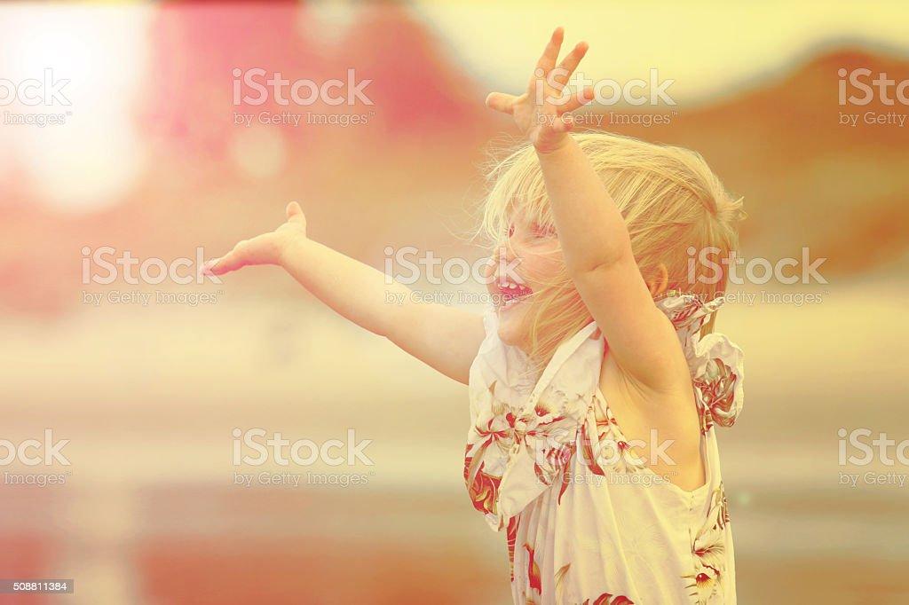 Cute little girl on the beach stock photo