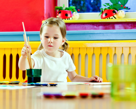 Cute Little Girl Painting Stock Photo - Download Image Now