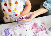 istock cute little girl painting with mommy together at home, portrait of mother and daughter painting at home 1142677988