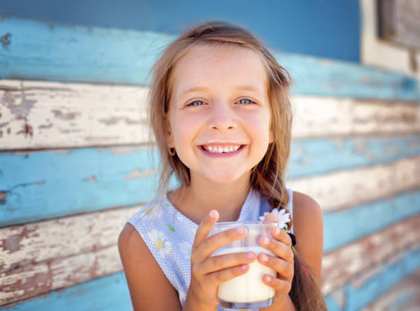 cute little girl - milk stock pictures, royalty-free photos & images