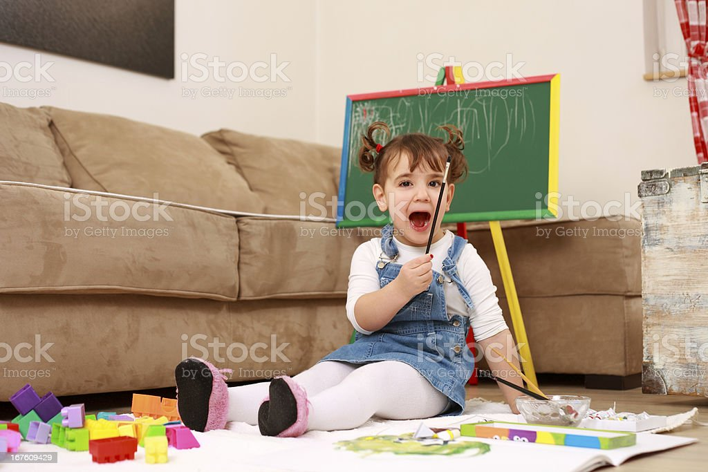 Cute little girl playing at home royalty-free stock photo