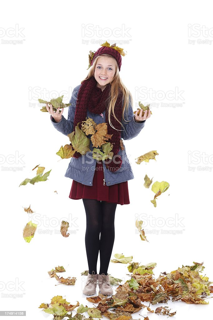 Cute little girl playing with autumn leaves stock photo