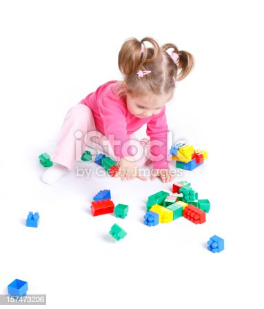 istock Cute little girl playing with blocks 157473206