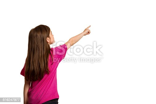 istock Cute little girl pointing with finger 516247977
