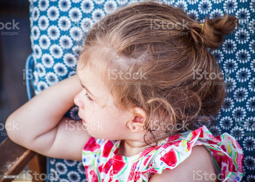 1372b3358ec1 Cute little girl portrait wearing strawberry dress and looking aside royalty -free stock photo