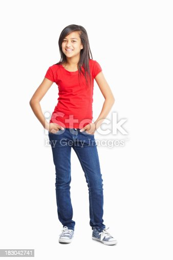 Full length of a cute little girl posing with hands in pockets isolated against white background