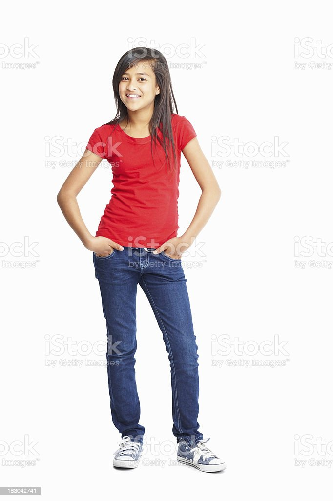 Cute little girl posing with hands in pockets stock photo