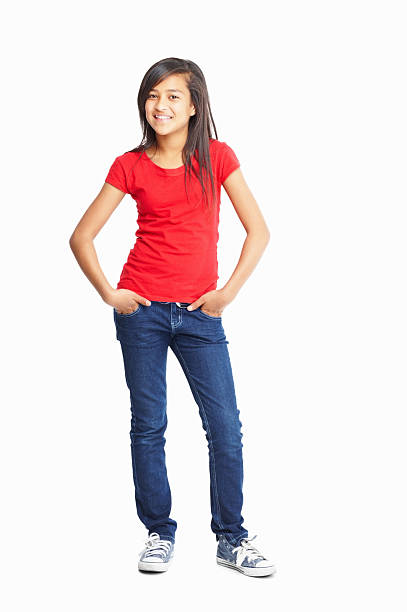 cute little girl posing with hands in pockets - tween models stock photos and pictures