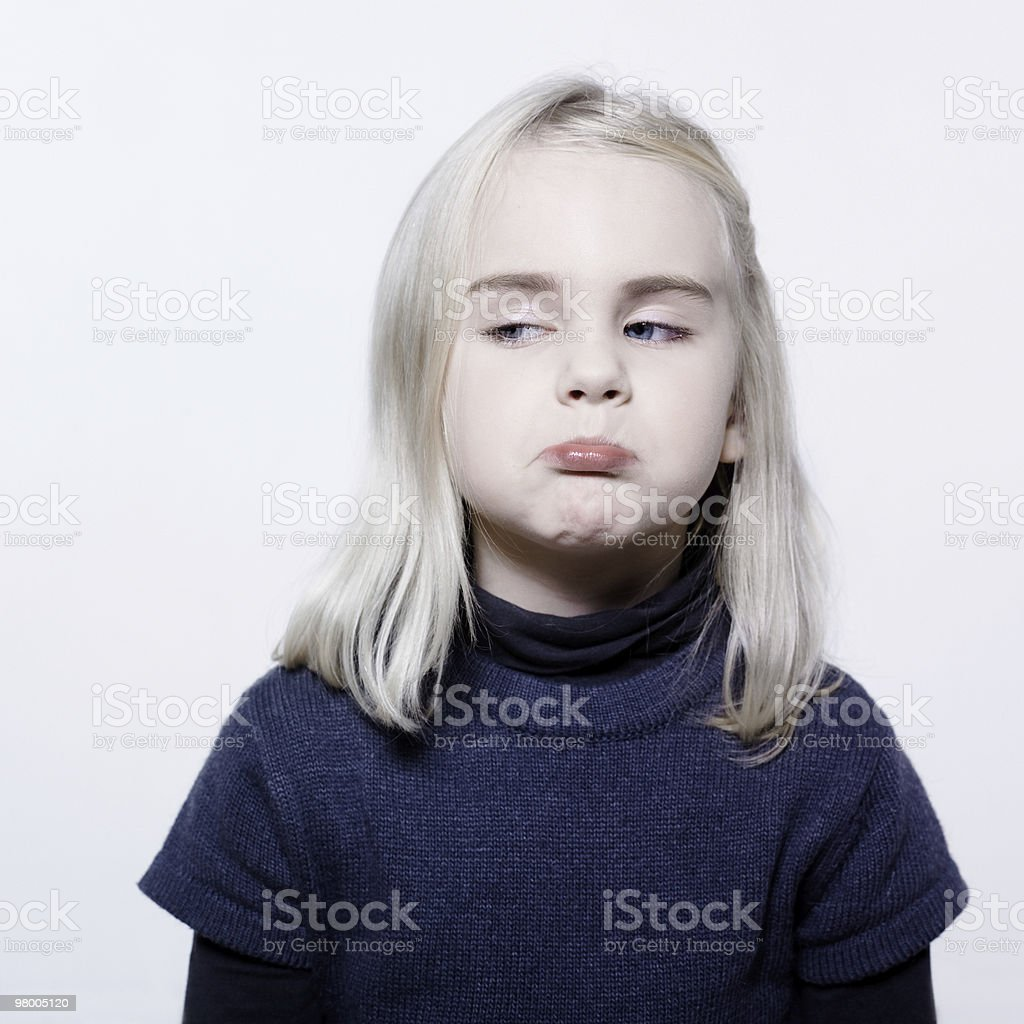 cute little girl puckering caucasian portrait pout sullen brat royalty-free stock photo