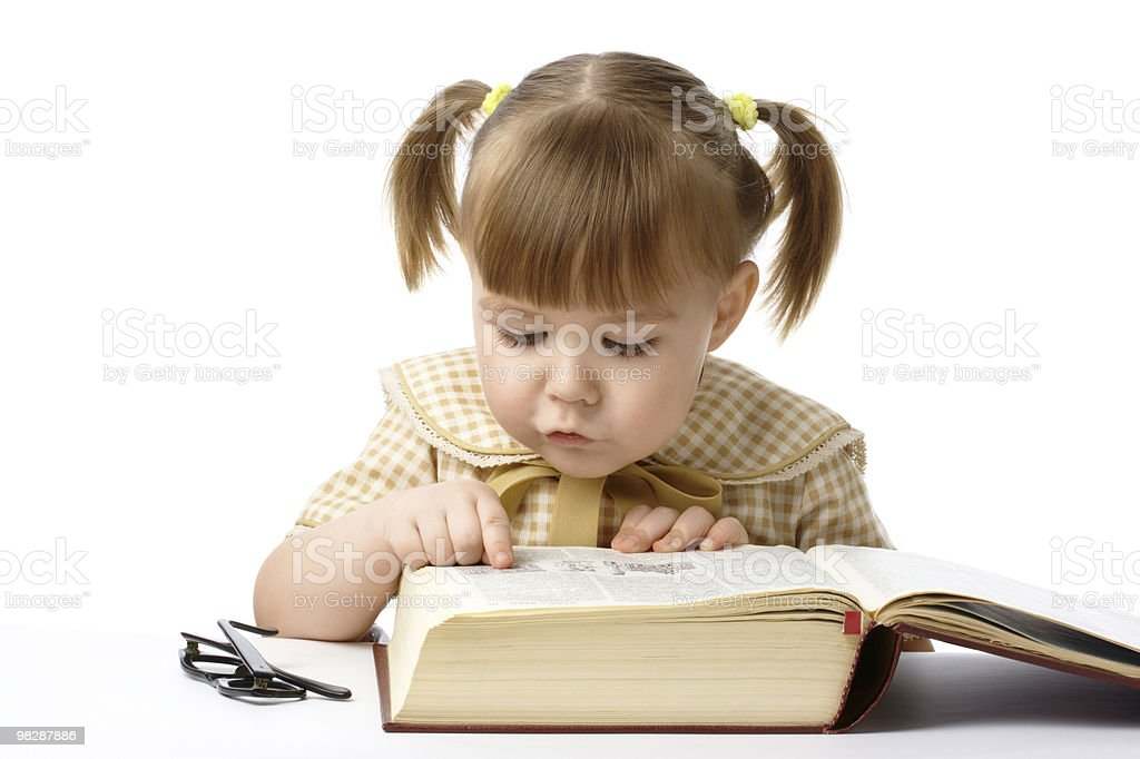 Cute little girl reading books, back to school royalty-free stock photo