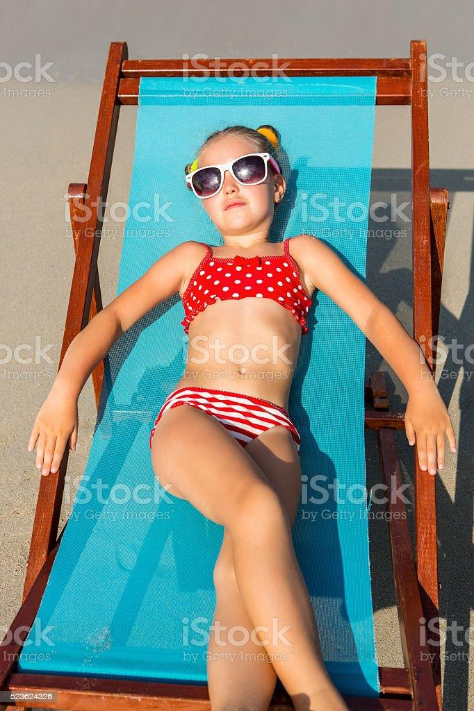 little girl sun PhotoDune