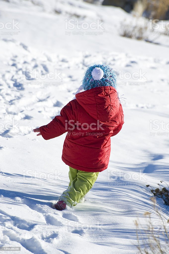 Cute Little Girl Running and Playing Cute Little Girl Running and Playing Adolescence Stock Photo