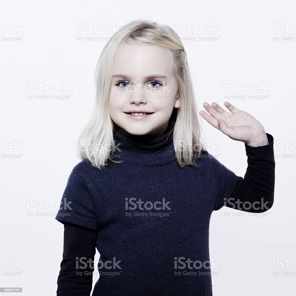 cute little girl saluting royalty free stockfoto