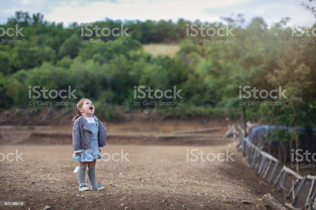 Cute little girl screaming stock photo