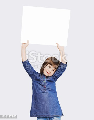 519837800 istock photo Cute little girl showing white banner 518197952