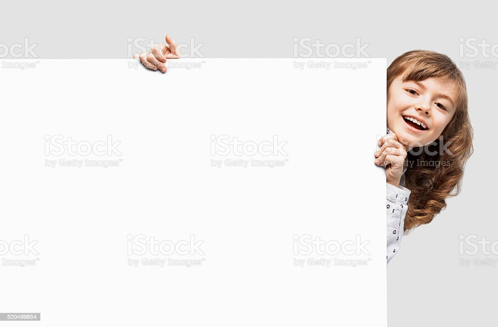 Cute little girl showing white banner stock photo