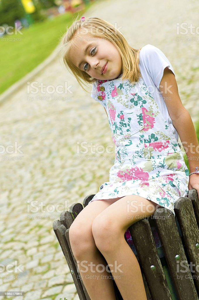 Cute Little Girl Sitting In The Garbage Can Stock Photo ...