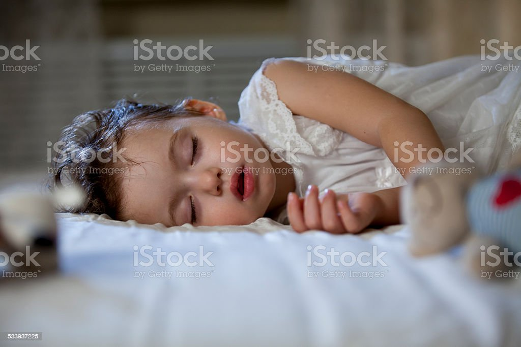 Cute little girl sleeping​​​ foto