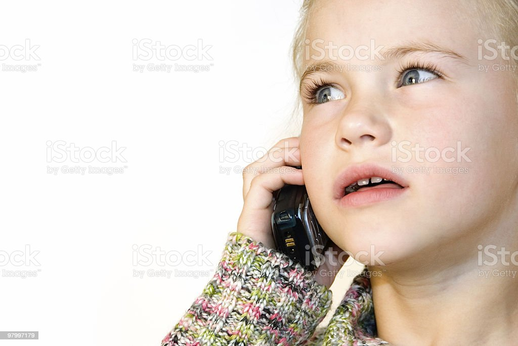 Cute little girl talking on the phone royalty-free stock photo