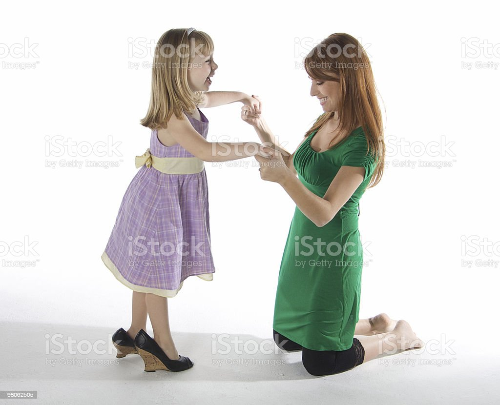 Cute little Girl Trying on Grown Up Shoes royalty-free stock photo