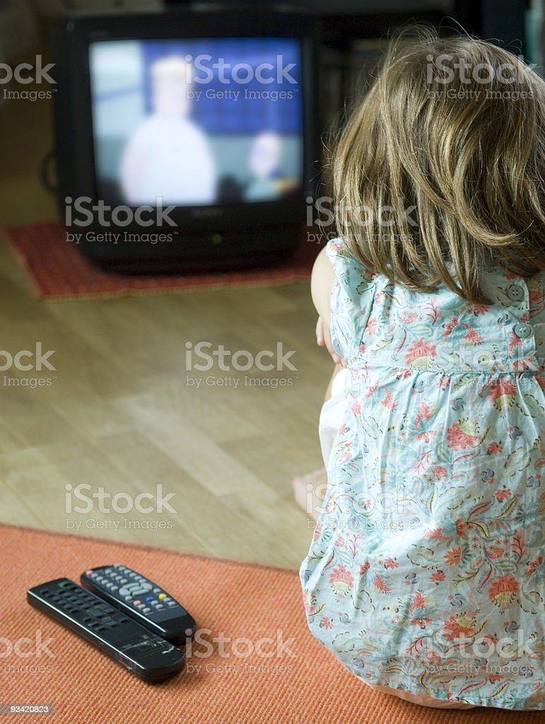 cute little girl watching television. royalty-free stock photo