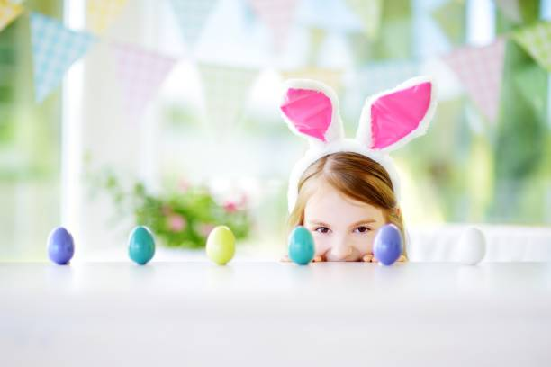 Cute little girl wearing bunny ears playing egg hunt on easter picture id656025856?b=1&k=6&m=656025856&s=612x612&w=0&h=u1pikibg 7hwiztnuti4dg1ipdosojt3rpefvlp8z c=