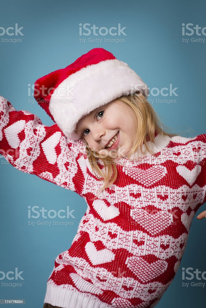 8bfc4157bf4c Cute Little Girl Wearing Santa Hat and Christmas Sweater royalty-free stock  photo