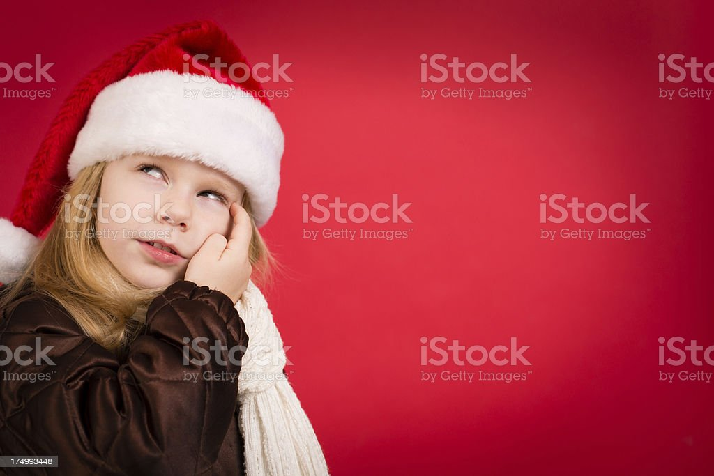 3a2d397040653 Cute Little Girl Wearing Santa Hat With Red Background Stock Photo ...