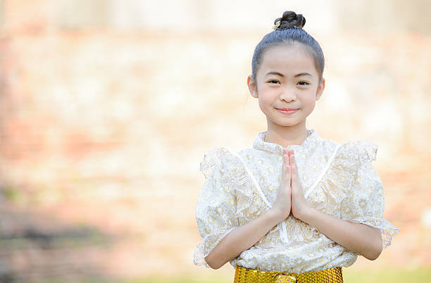 Royalty free thai greetings pictures images and stock photos istock cute little girl wearing thai dress pay respect stock photo m4hsunfo