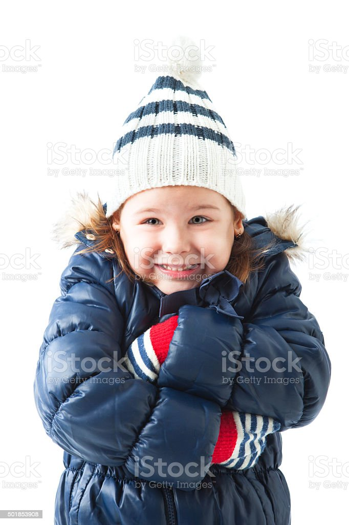Cute little girl wearing winter hat and gloves posing stock photo