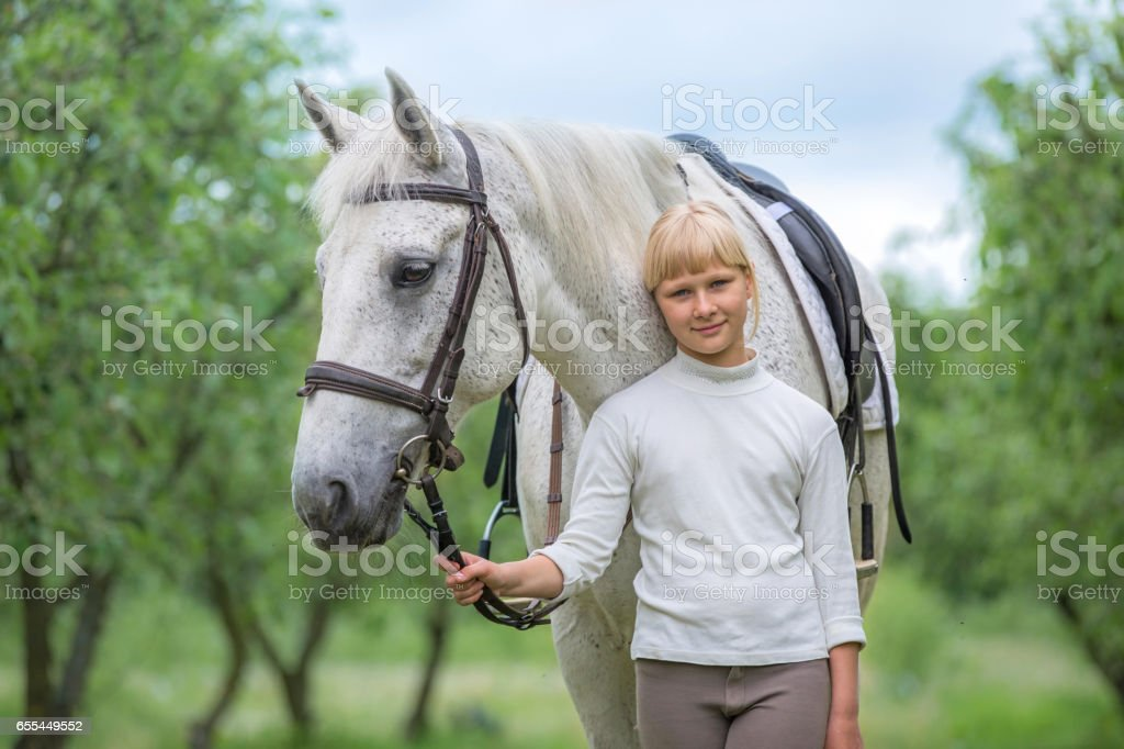 Cute little girl with a horse stock photo
