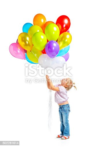 istock Cute little girl with balloons 502281614