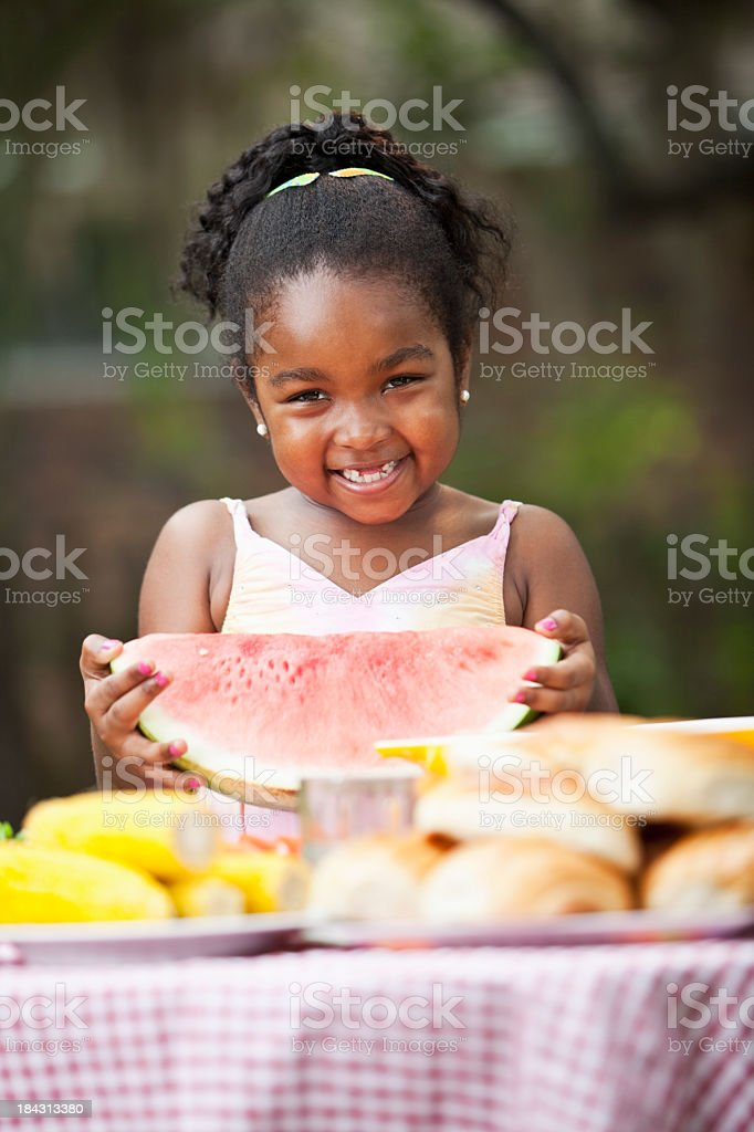 Cute little girl with big slice of watermelon stock photo
