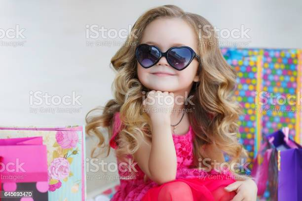 Cute little girl with colorful bags for shopping in supermarket picture id645693470?b=1&k=6&m=645693470&s=612x612&h=lwuyqbizuqbym1pesqy6ig5g5om8 joq4jugfifxrkq=