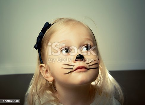 487217358 istock photo Cute little girl with face painted. 475866346