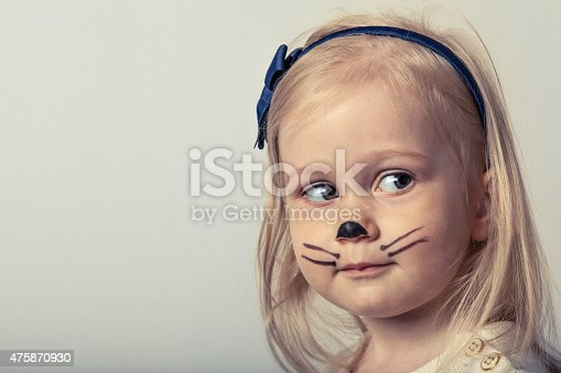 487217358 istock photo Cute little girl with face painted. 475870930