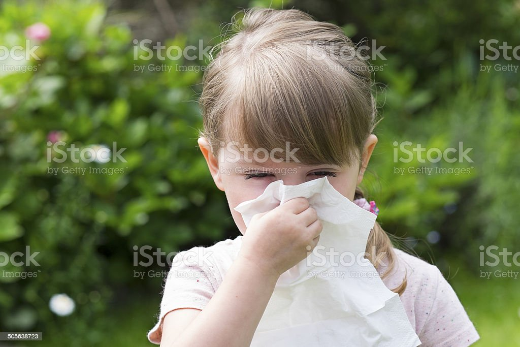 Cute little girl with handkerchief in a garden stock photo
