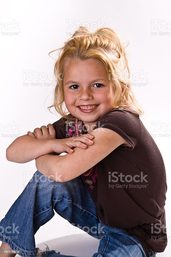Cute little girl with her arms crossed royalty-free stock photo