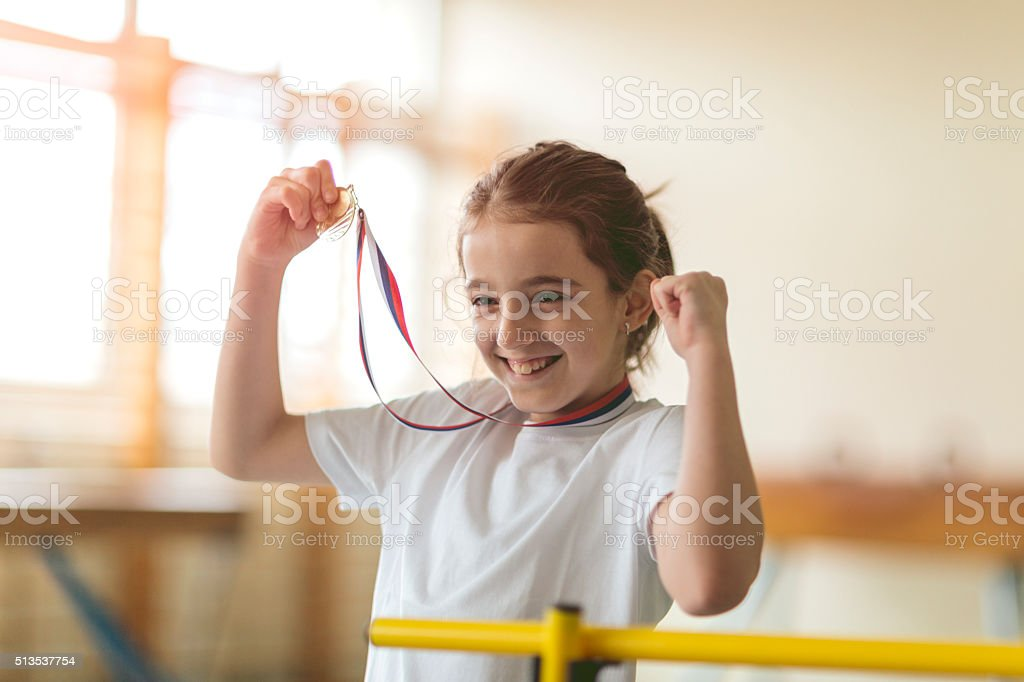 Cute Little Girl With Her First Medal. stock photo