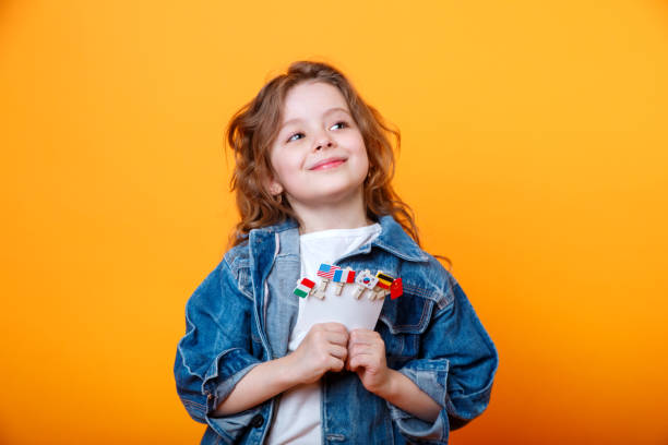 Cute little girl with icons of different flags on yellow background picture id1188852112?b=1&k=6&m=1188852112&s=612x612&w=0&h=372ffkvbsztn9nf5uz97addodf1pbsjb5fgurhxzfei=